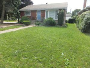 TOTALLY UPDATED ON BOTH LEVELS**DOUBLE DRIVEWAY**GARAGE