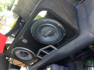 "2 10"" infinity subs in a nice clean ported bass worx box"