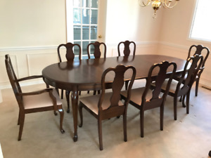Solid cherry wood dinning room table, 8 chairs, 1 dining cabinet