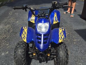 Kids Four Wheeler.  50cc.  2 Helmuts