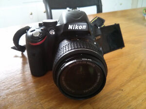 Nikon D5100 with 18-55mm and 55-300mm lenses