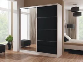 Brand New High Quality Wika Wardrobe with High Gloss Doors and Full Mirror in Black and White Colors
