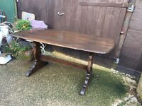 Dark wood Ercol refectory dining table