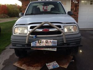 1999  Chevy tracker lifted/7.5 ft snow bear plow