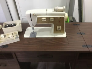 Singer Golden touch and sew sewing machine in cabinet./ chair