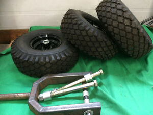 3 CARLISLE TIRES WITH HUBS AND BEARINGS
