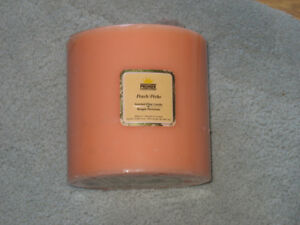 Premier Candle Corp Scented 3 wick Peach Pillar candle.