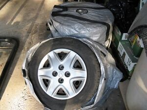 "Set of 4 rims 14"" with hubcaps and tire bags"