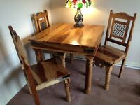 Solid Sheesham dining table and 4 chairs....reduced again. Bargain