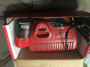 Milwaukee Battery charger and M12 battery  mint condition