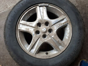 I'm selling a set of two Ford Windstar tires and rims.