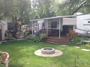 Innsbruck trailer on lot for sale-includes deck/hard awning/shed