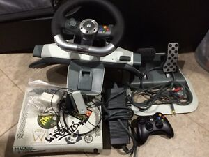 Xbox 360 console setup with sports games and driving equipment