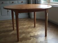 Extending dining table seats 10