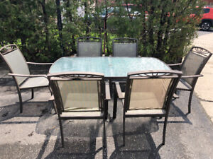 Patio dinning set. Table and six chairs