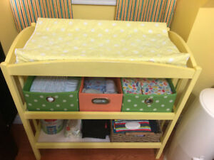 Change table - yellow with colourful storage baskets