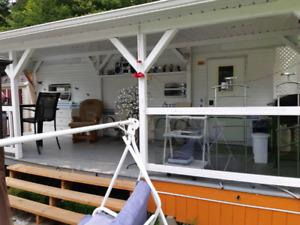 Roulotte 27 pieds,kart de golf,très grand patio,REMISE ect