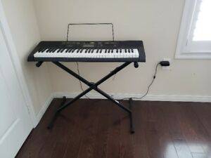 CASIO KEYBOARD AND STAND FOR SALE