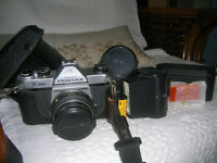 Pentax K1000 camera with accessories