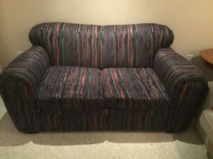 Black with Multicolored stripes Loveseat. REDUCED