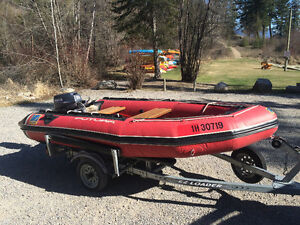 Zodiac inflatable boat with 25 hp Yamaha and EZ-Load trailer