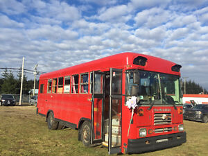 Big Red School Bus Conversion - perfect for your new airbnb!