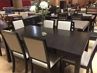 Liquidation black table with light gray chairs