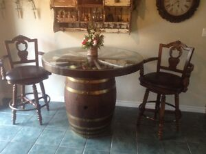 Barrel table with antique wagon wheel and 2 chairs