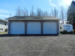 Home and Triple car garage on 2 acres