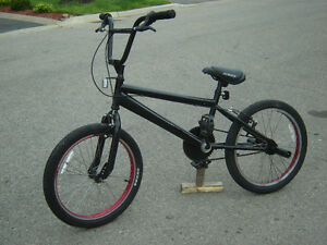 "LIKE NEW 20"" BLACK BMX WITH STUT PEGS QUICK SALE $90.00 FIRM!"