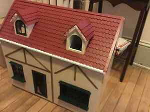Doll house with furniture and miniture figures