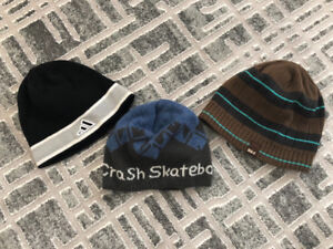 Four different kids toques for sale for $ five dollars each