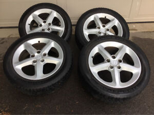 Uniroyal Tiger Paw Touring tires with alloy wheels. 215/55/R17 9