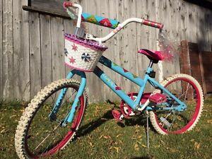Vélo fille bleu et rose presque neuf