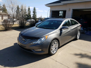2013 hyundai 2.0l T, remote start, ext warranty, 2 sets of tires