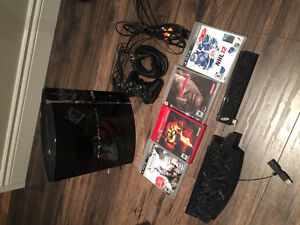 80 GB PS3 (backwards compatible with PS2 and PS1) & 4 games
