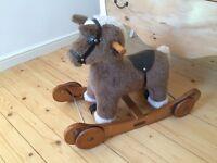 Mamas and papas rocking and ride horse