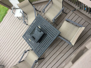 Patio table 4 chairs .  Built in propane bbq in centre of table