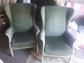 Matching pair of Parker Knoll green velvet chairs Dorset
