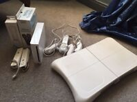 Wii console, dance board, microphones & 18 games for sale