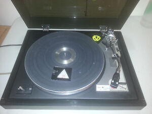 Turntable with box of records.
