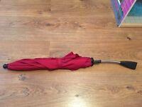 Red and black mamas and papas parasols