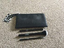 Boots black glitter makeup bag and brush set.