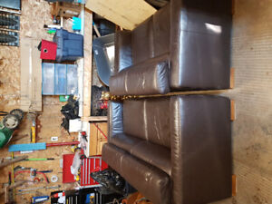 Italian leather coach and loveseat.