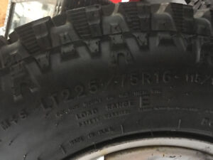 4 rims with two brand new mud terrain tires