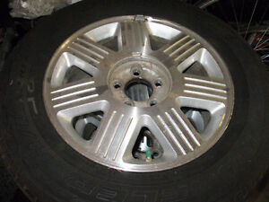 A  Set  of  4   Tires  &  4   Rims  245-55-17  Holding  AIR.