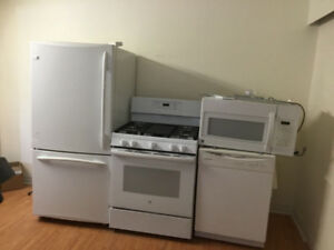 Almost new 4 piece kitchen appliances fridge stove dishwasher