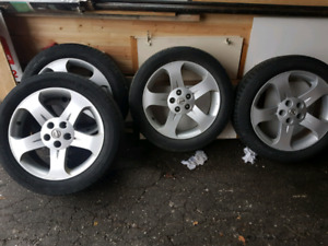 "18"" Nissan Aluminum rims with pirelli tires"
