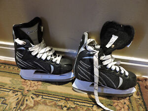 several pairs of skates for sale