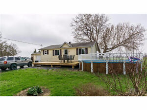 This beautiful remodeled bungalow has water access with a dock!